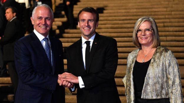 French President Emmanuel Macron (centre) meets with Australian Prime Minister Malcolm Turnbull and his wife Lucy Turnbull at the Sydney Opera House on May 1, 2018 in Sydney, Australia.