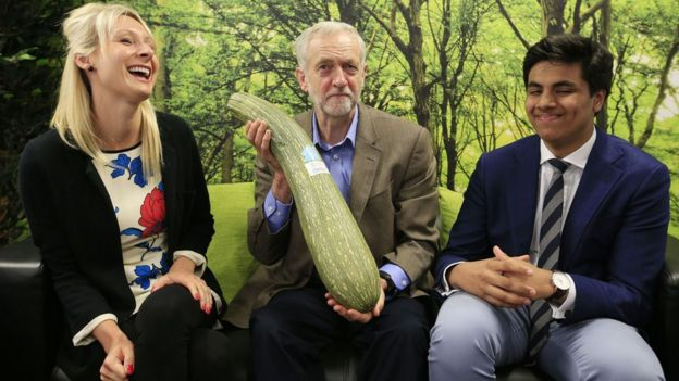 Jeremy Corbyn is presented with a marrow during a visit to a Brighton business centre