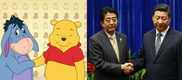 Winnie the Pooh juxtaposed next to President Xi Jinping and PM Shinzo Abe