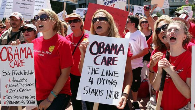 Anti-Obamacare protesters hold up signs at a 2009 rally.