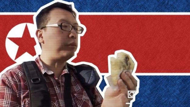 Aram Pan y bandera norcoreana