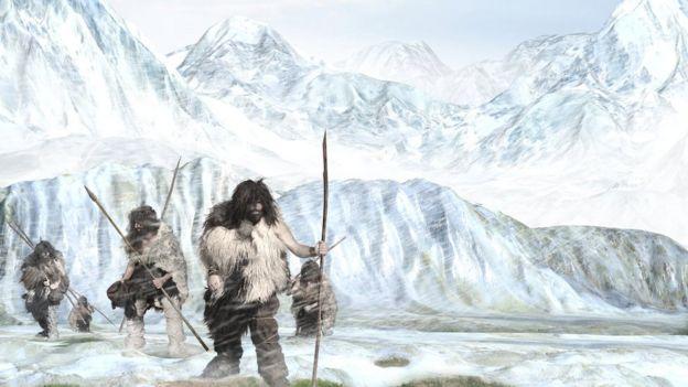 escena de hombres de la edad de hielo caminando