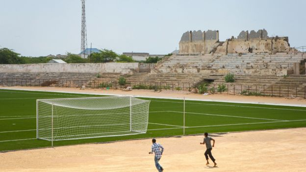 Two Somali men jogging near the football pitch inside Baanadir Stadium in the Somali capital Mogadishu in 2013