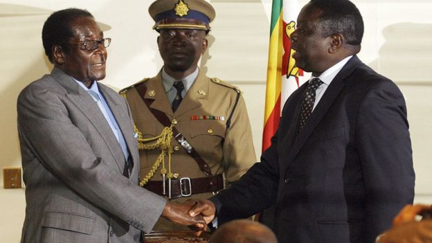 Mr Mugabe shakes hands with Mr Tsvangirai after a power-sharing agreement in 2008