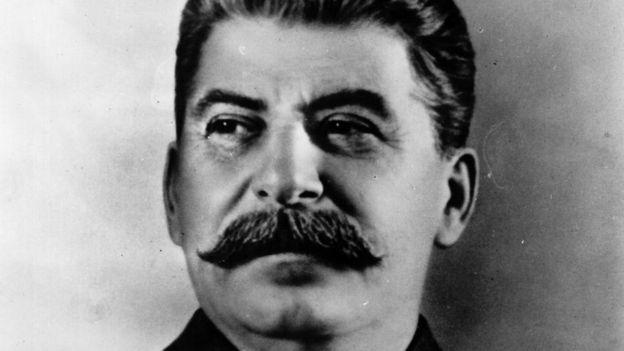 A black and white portrait of Joseph Stalin