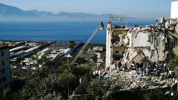 View of collapsed building by Bay of Naples, 7 Jul 17