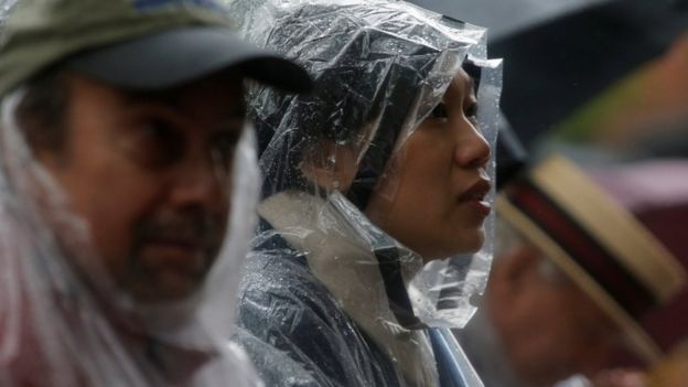 Priscilla Chan in rain gear