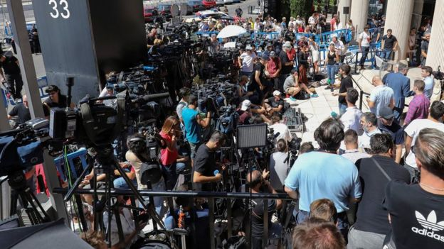 Members of the media gather outside the courthouse where Real Madrid's Portuguese star Cristiano Ronaldo was testifying on charges of tax fraud in Pozuelo de Alarcon, outside Madrid, Spain, 31 July 2017