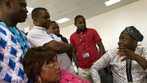A Yoruba language professor (right) talking to the BBC Yoruba team