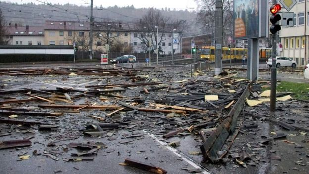 Debris of a roof lay in a street in Stuttgart, south-western Germany, after the region was hit by Storm Burglind on 3 January 2018
