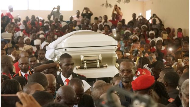 The casket of late opposition leader Morgan Tsvangirai is carried into Mabelreign Methodist Church in Harare for a memorial service on February 18, 2018.