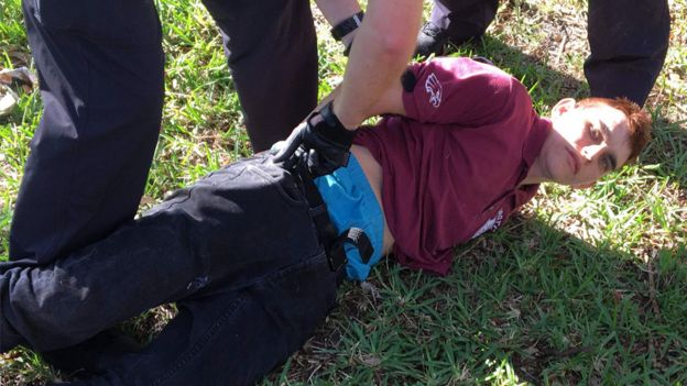 Nikolas Cruz on ground, being arrested