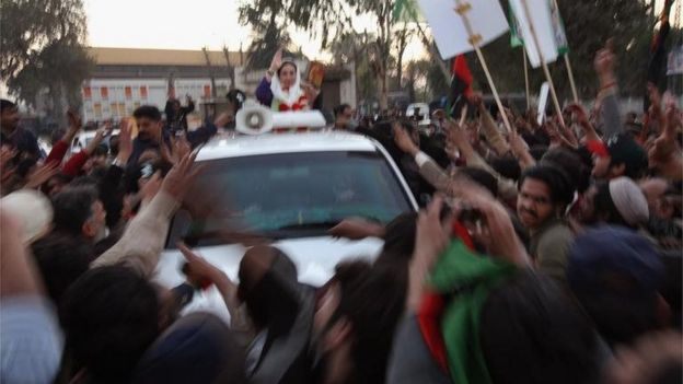 Former Prime Minister Benazir Bhutto waves from her car just seconds before being attacked on December 27, 2007 in Rawalpindi, Pakistan.
