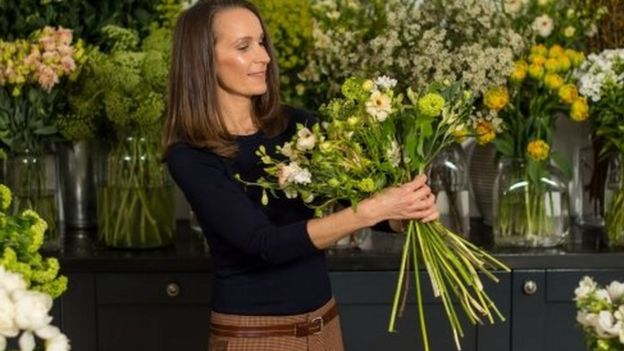 Philippa Craddock holding flowers