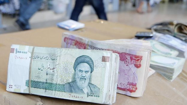 Iranian rial banknotes bearing a portrait of the late founder of the Islamic Republic of Iran, Ayatollah Ruhollah Khomeini, 19 June 2014