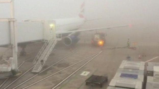Plane in fog at Manchester airport