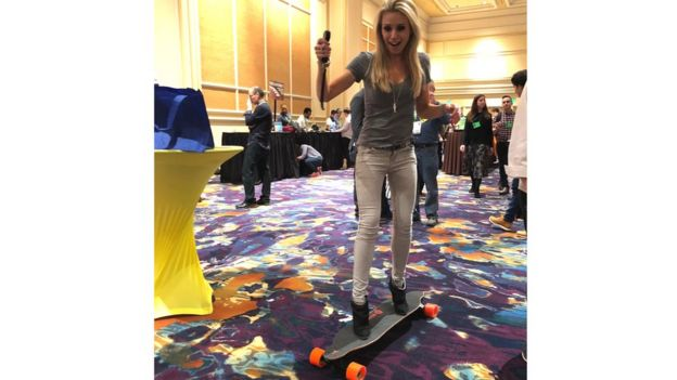 BBC presenter Lara Lewington on an electronic remote control skateboard