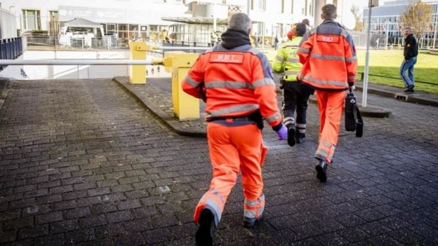 Emergency rescue worker run to the court building in The Hague