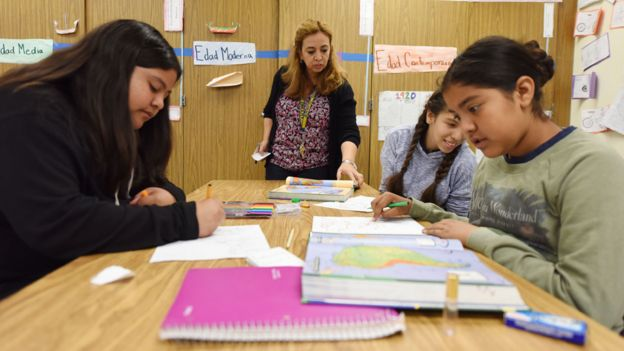 Instructor Blanca Claudio (C) teaches a history lesson in Spanish in a Dual Language Academy class at Franklin High School in Los Angeles, California, on May 25, 2017.