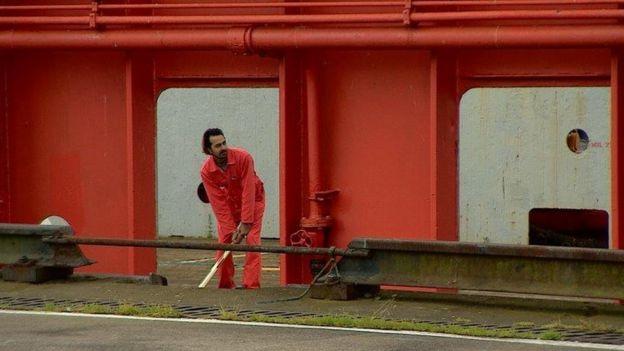 Crew member playing cricket
