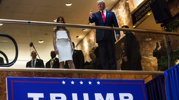 Donald Trump gives a thumbs-up before announcing his presidential campaign in 2015