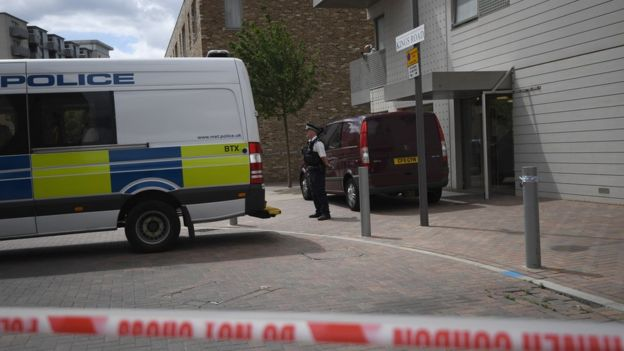 Police outside flat linked to suspect in Barking