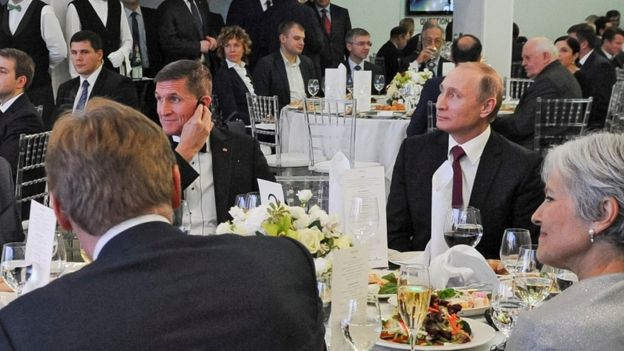 In this file photo taken on 10 December 2015, Russian President Vladimir Putin is seen centre right with retired US Lt Gen Michael Flynn, centre left