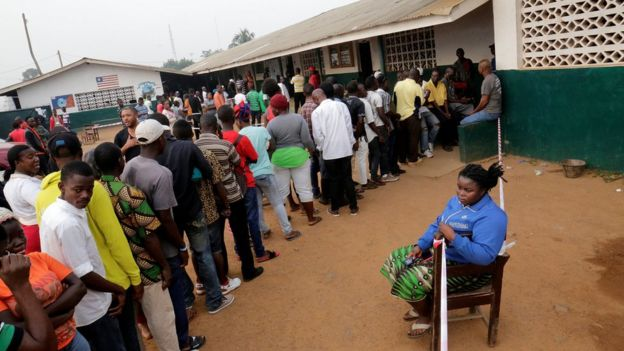 People wait to vote during the presidential election at a polling station in Monrovia, Liberia December 26, 2017