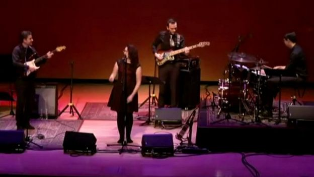 Mandy Harvey on stage with her band