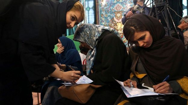 Iranian women at a polling station in Tehran (file photo)