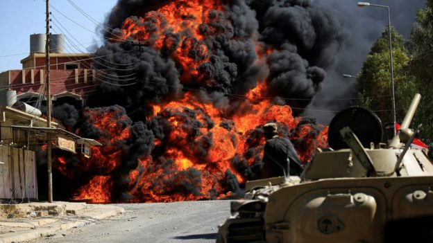 Smoke rises during clashes between Iraqi forces and so-called Islamic State (IS) militants in Tal Afar, 26 August 2017