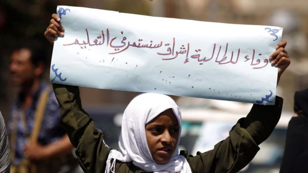 Demonstrating outside the UN office in Sanaa, a girl holds a banner saying: