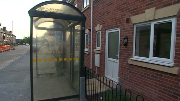 Bus shelter blocking house in Langley Mill