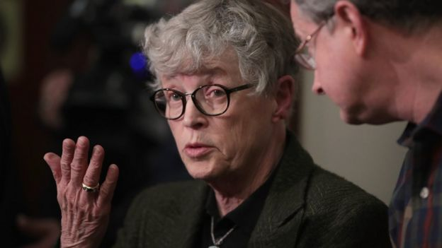 Michigan State University (MSU) President Lou Anna Simon answers a question after being confronted by former MSU gymnast Lidsey Lemke d