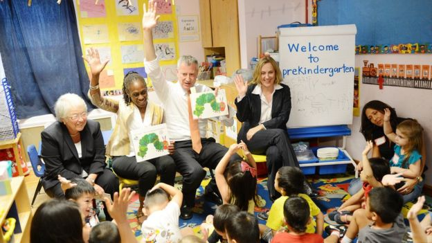 New York Mayor Bill de Blasio (Center-R), along with Schools Chancellor Carmen Farina (L), First Lady Chirlane McCray (C), and Queens Borough President Melinda Katz (R), visits Pre-K classes at Home Sweet Home Children's School in Queens on the first day of NYC public schools, September 4, 2014