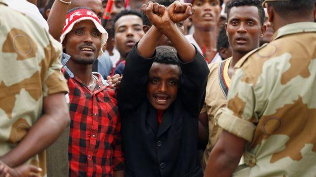 Demonstrators chant slogans while flashing the Oromo protest gesture during Irreecha, the thanksgiving festival of the Oromo people, in Bishoftu town, Oromia region, Ethiopia, 2 October 2016.