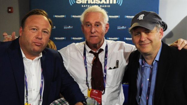 Jones along with former Trump campaign advisor Roger Stone and journalist Jonathan Alter at the 2016 Republican National Convention in Cleveland, Ohio