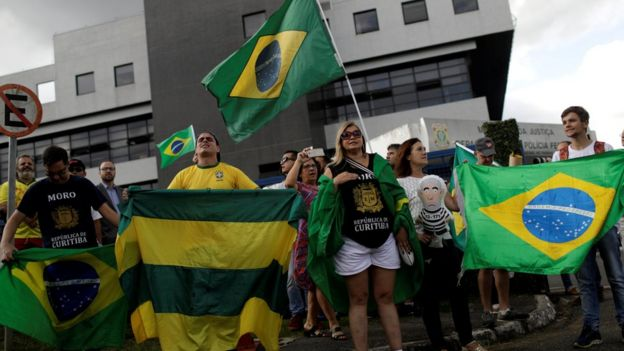 Supporters of Judge Sergio Moro demonstrate outside federal police HQ in Curitiba