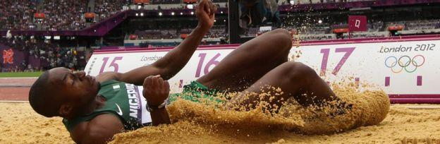 Tosin Oke in the sand