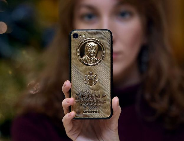 A gold-plated smartphone bearing Trump's likeness is sold at a boutique in Moscow