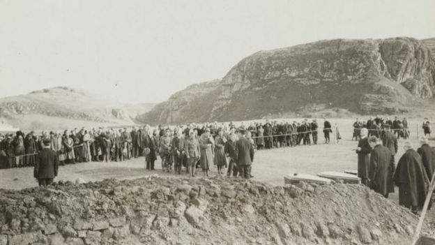 Funeral of 199 American soldiers, victims of the Otranto disaster, at Kilchoman, Islay, Scotland. Coffins seen in the foreground were made by local workmen. American army and Red Cross officers in foreground