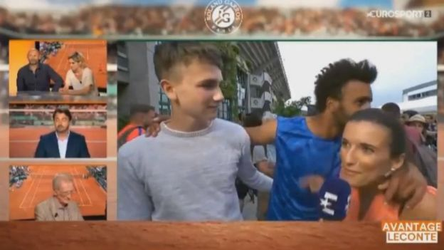Still taken from video - Maxime Hamou tries to kiss Maly Thomas
