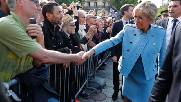 Brigitte Trogneux, wife of French President Emmanuel Macron, greets the crowd outside the City Hall on May 14, 2017 in Paris
