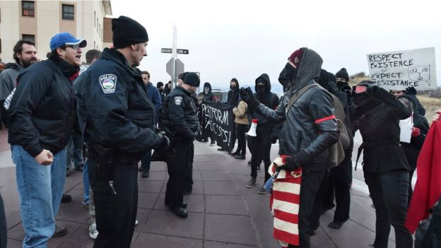 Colorado Springs police make a barrier between protesters against Milo Yiannopoulos, who are on the right, and those going to hear him speak at University of Colorado in January 2017
