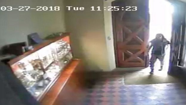 CCTV image of man at church doors