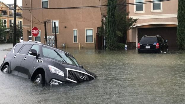 A vehicle partially submerged by floodwaters in Houston