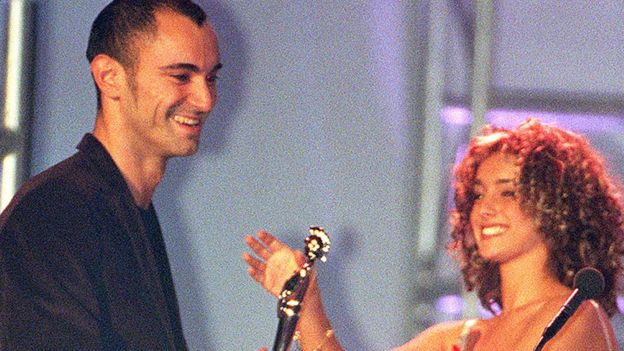 Robert Miles collects his Brit Award from Louise From Eternal