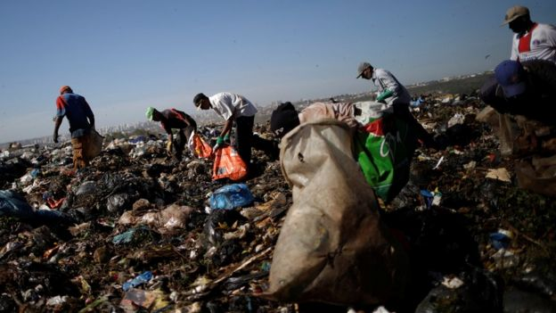 Waste pickers work at Lixao da Estrutural, Latin America's largest rubbish dump, in Brasilia, Brazil, 19 January 2018