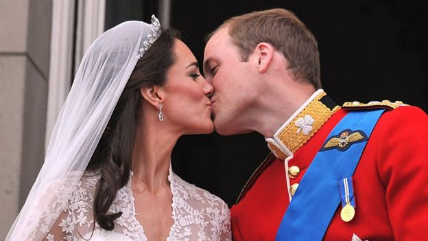 Duke of Cambridge kisses the Duchess of Cambridge on their wedding day.