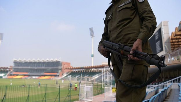 A Pakistani policeman stands guard while national cricket team players take part in a practice session at the Gaddafi Cricket Stadium in Lahore on 8 September 2017, for the forthcoming World XI tour to Pakistan
